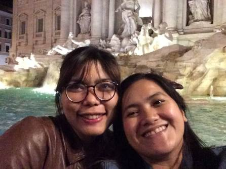 Our faces at the Trevi Fountain lol